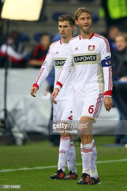 Daniel Schwaab and Simon Rolfesof Leverkusen look dejected after the 11 draw of the UEFA Champions League group E match between KRC Genk and Bayer 04...