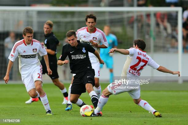 Daniel Schwaab of Leverkusen and Gonzalo Castro challenges Kevin WOlze of Duisburg during the friendly match between Bayer Leverkusen and MSV...