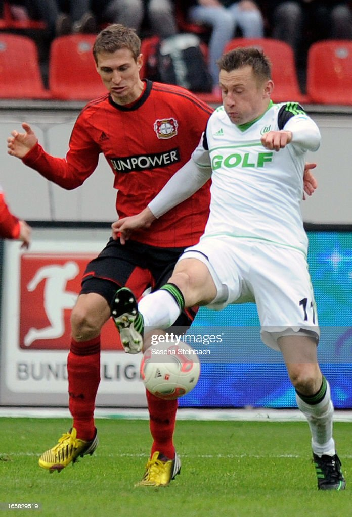 Daniel Schwaab (L) of Leverkusen and Ivica Olic (R) of Wolfsburg battle for the ball during the Bundesliga match between Bayer 04 Leverkusen and VfL Wolfsburg at BayArena on April 6, 2013 in Leverkusen, Germany.