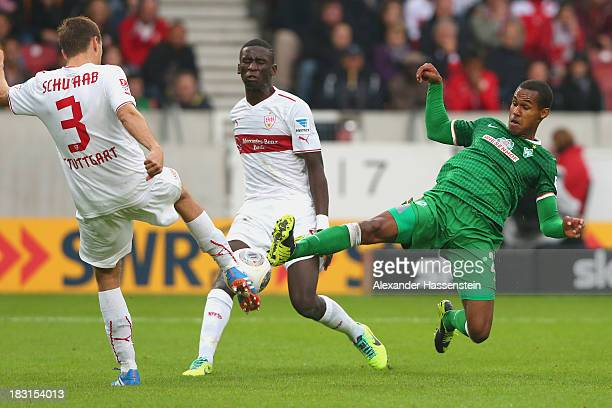 Daniel Schwaab of Stuttgart and his team mate Antonio Ruediger battle for the ball with Theodor Gebre Selassie of Bremen during the Bundesliga match...