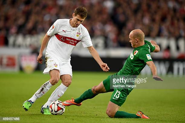 Daniel Schwaab of Stuttgart battles for the ball with Tobias Werner of Ausgburg during the Bundesliga match between VfB Stuttgart and FC Augsburg at...