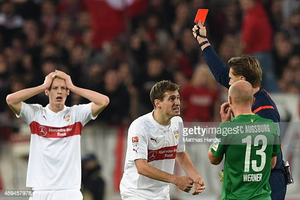 Daniel Schwaab of Stuttgart receives the red card from referee Thorsten Kinhoefer whilst his team mate Timo Baumgartl reacts during the Bundesliga...