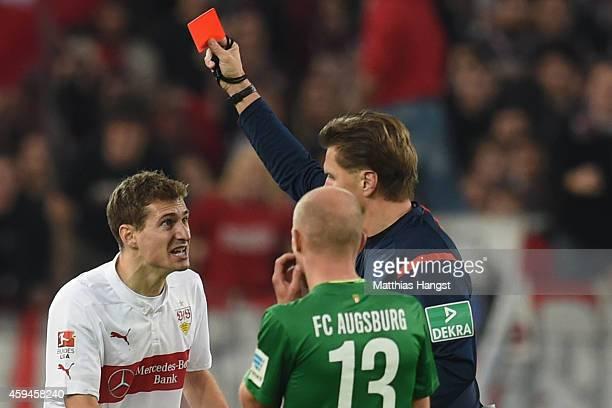 Daniel Schwaab of Stuttgart receives the red card from referee Thorsten Kinhoefer during the Bundesliga match between VfB Stuttgart and FC Augsburg...