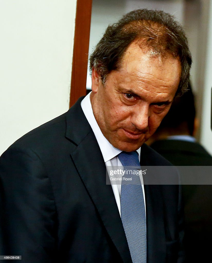 <a gi-track='captionPersonalityLinkClicked' href=/galleries/search?phrase=Daniel+Scioli&family=editorial&specificpeople=616127 ng-click='$event.stopPropagation()'>Daniel Scioli</a> Governor of Buenos Aires during a press conference at the Presidential Palace on September 30, 2014 in Buenos Aires, Argentina. After United States judge Thomas Griesa held Argentina in contempt of court on September 29th, Fernandez made reference to Griesa's decision on the bond payment case.