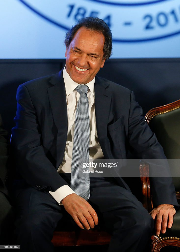 <a gi-track='captionPersonalityLinkClicked' href=/galleries/search?phrase=Daniel+Scioli&family=editorial&specificpeople=616127 ng-click='$event.stopPropagation()'>Daniel Scioli</a> presidential candidate and Governor of Buenos Aires, smiles during a ceremony commemorating the 161st anniversary of the Buenos Aires Stock Exchange on August 26, 2015 in Buenos Aires, Argentina.