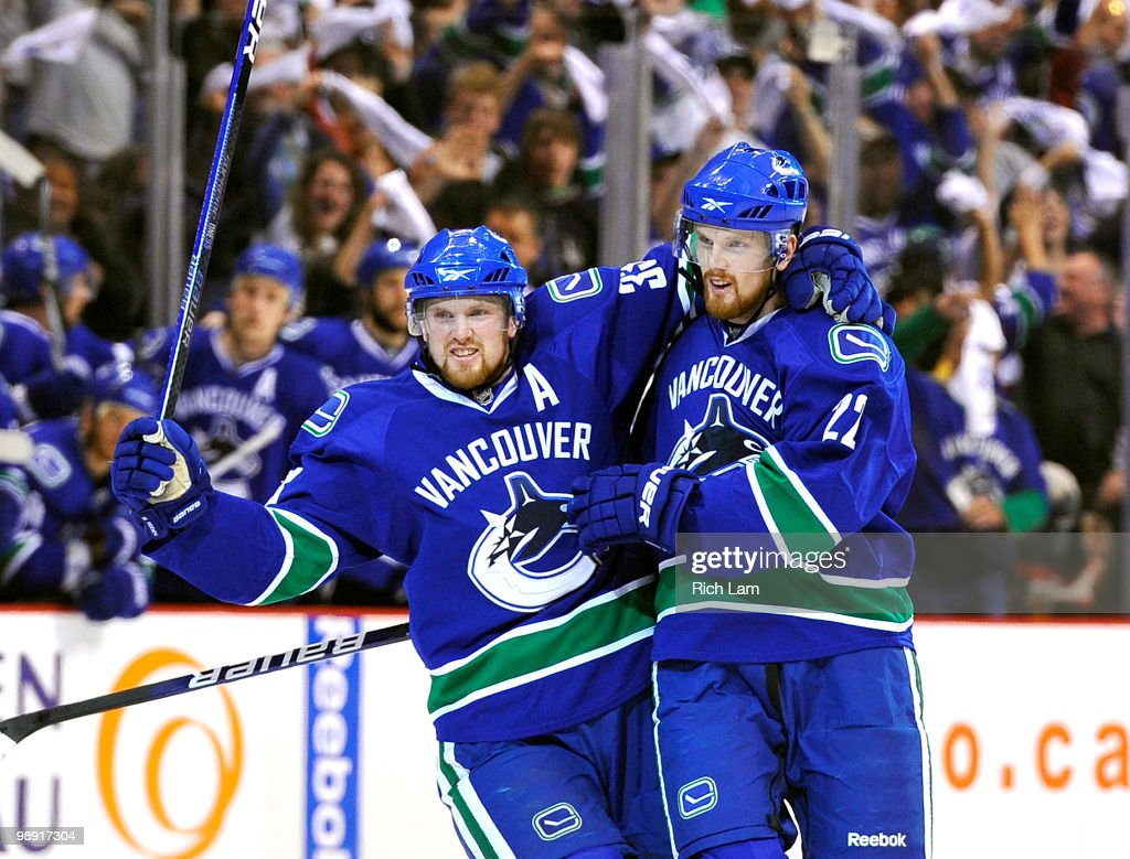 <a gi-track='captionPersonalityLinkClicked' href=/galleries/search?phrase=Daniel+Sedin&family=editorial&specificpeople=202492 ng-click='$event.stopPropagation()'>Daniel Sedin</a> #22 and <a gi-track='captionPersonalityLinkClicked' href=/galleries/search?phrase=Henrik+Sedin&family=editorial&specificpeople=202574 ng-click='$event.stopPropagation()'>Henrik Sedin</a> #33 of the Vancouver Canucks celebrate after <a gi-track='captionPersonalityLinkClicked' href=/galleries/search?phrase=Daniel+Sedin&family=editorial&specificpeople=202492 ng-click='$event.stopPropagation()'>Daniel Sedin</a> scored against the Chicago Blackhawks during the first period in Game Four of the Western Conference Semifinals during the 2010 NHL Stanley Cup Playoffs on May 07, 2010 at General Motors Place in Vancouver, British Columbia, Canada.