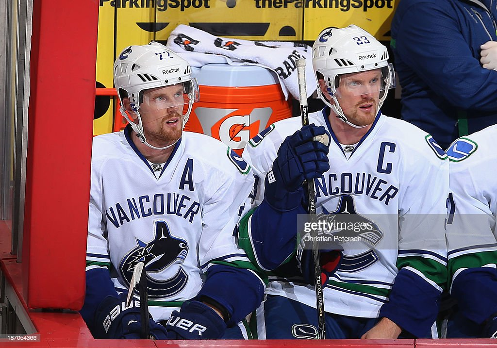<a gi-track='captionPersonalityLinkClicked' href=/galleries/search?phrase=Daniel+Sedin&family=editorial&specificpeople=202492 ng-click='$event.stopPropagation()'>Daniel Sedin</a> #22 and <a gi-track='captionPersonalityLinkClicked' href=/galleries/search?phrase=Henrik+Sedin&family=editorial&specificpeople=202574 ng-click='$event.stopPropagation()'>Henrik Sedin</a> #33 of the Vancouver Canucks watch from the bench during the NHL game against the Phoenix Coyotes at Jobing.com Arena on November 5, 2013 in Glendale, Arizona. The Coyotes defeated the Canucks 3-2 in an overtime shoot out.