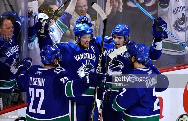 Daniel Sedin Henrik Sedin Alex Burrows and Dan Hamhuis of the Vancouver Canucks celebrate Burrows' first period goal in Game Five of the Western...