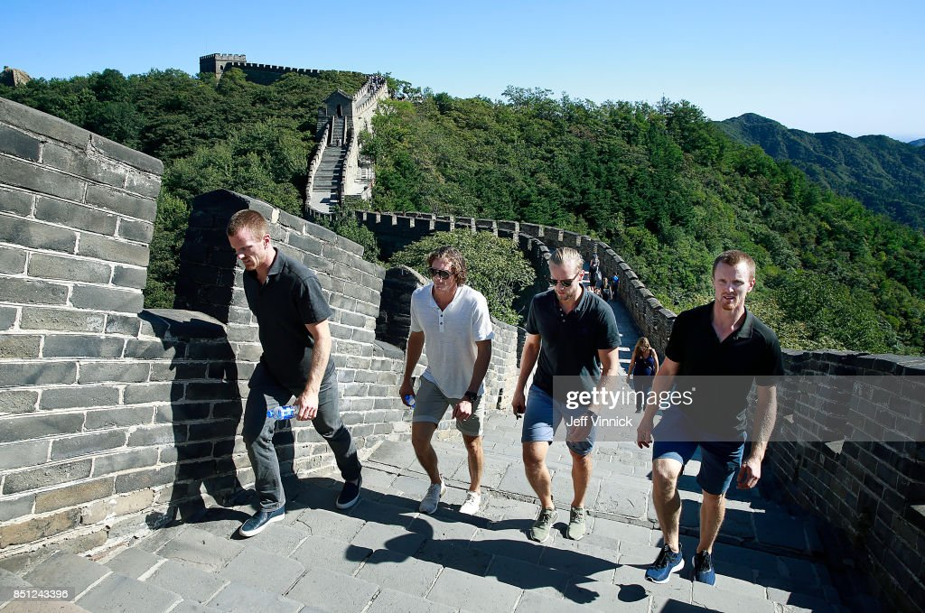 Daniel Sedin, Loui Eriksson, Alexander Edler and Henrik Sedin #33 of the Vancouver Canucks climb the Great Wall of China September 22, 2017 in Beijing, China. The Vancouver Canucks and the LA Kings are playing two pre-season games in China this week.