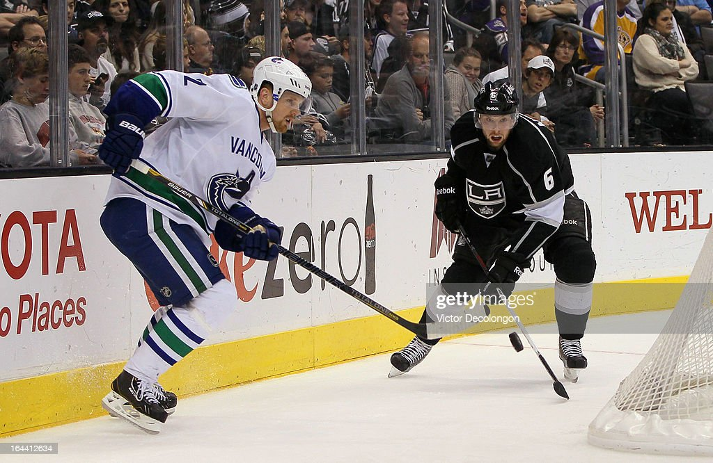 Daniel Sedin #22 of the Vancouver Canucks and Jake Muzzin #6 of the Los Angeles Kings vie for the puck behind the net during their NHL game at Staples Center on March 23, 2013 in Los Angeles, California. The Canucks defeated the Kings 1-0.