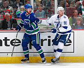 Daniel Sedin of the Vancouver Canucks and Steven Stamkos of the Tampa Bay Lightning skate up ice during their NHL game at Rogers Arena October 18...