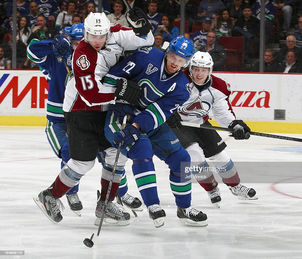 <a gi-track='captionPersonalityLinkClicked' href=/galleries/search?phrase=Daniel+Sedin&family=editorial&specificpeople=202492 ng-click='$event.stopPropagation()'>Daniel Sedin</a> #22 of the Vancouver Canucks battles PA Parenteau #15 of the Colorado Avalanche for the puck during an NHL game at Rogers Arena March 28, 2013 in Vancouver, British Columbia, Canada. Vancouver won 4-1.