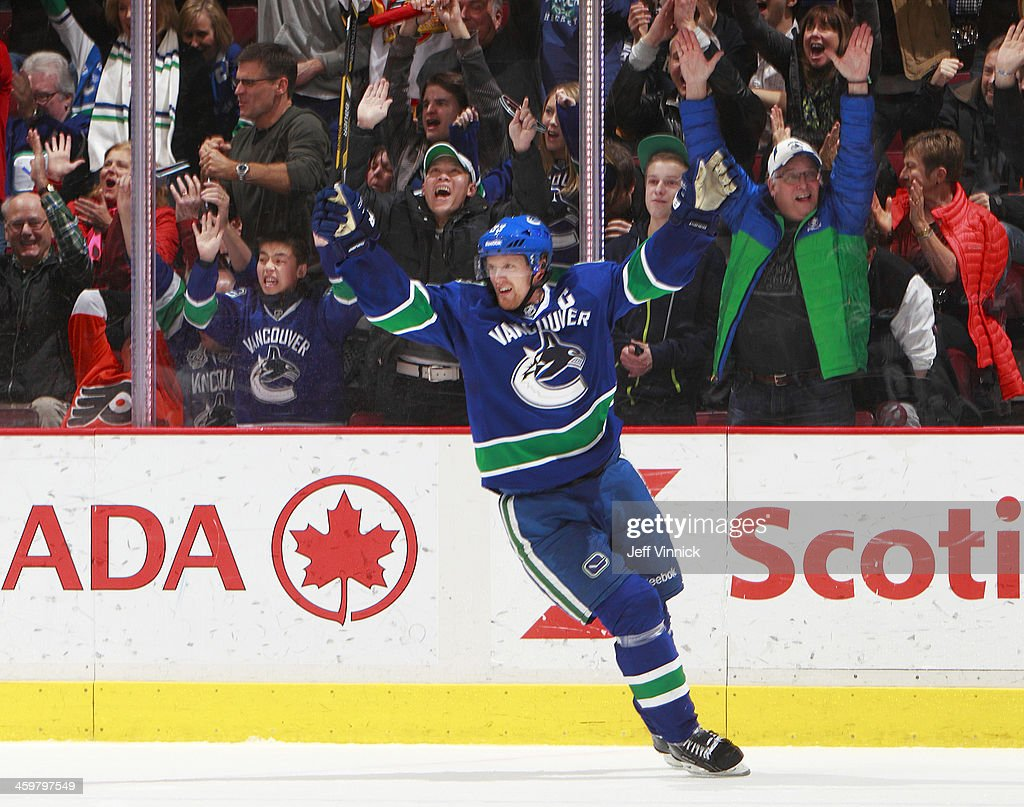 Daniel Sedin #22 of the Vancouver Canucks celebrates a goal against the Philadelphia Flyers during their NHL game at Rogers Arena December 30, 2013 in Vancouver, British Columbia, Canada. Philadelphia won 4-3.