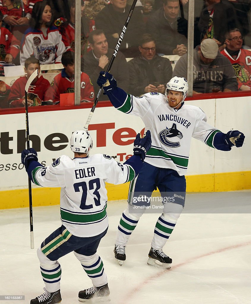 <a gi-track='captionPersonalityLinkClicked' href=/galleries/search?phrase=Daniel+Sedin&family=editorial&specificpeople=202492 ng-click='$event.stopPropagation()'>Daniel Sedin</a> #22 of the Vancouver Canucks celebrates his goal against the Chicago Blackhawks with <a gi-track='captionPersonalityLinkClicked' href=/galleries/search?phrase=Alexander+Edler&family=editorial&specificpeople=882987 ng-click='$event.stopPropagation()'>Alexander Edler</a> #23 at the United Center on February 19, 2013 in Chicago, Illinois.