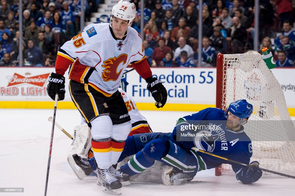 <a gi-track='captionPersonalityLinkClicked' href=/galleries/search?phrase=Daniel+Sedin&family=editorial&specificpeople=202492 ng-click='$event.stopPropagation()'>Daniel Sedin</a> #22 of the Vancouver Canucks falls to the ice after being checked by <a gi-track='captionPersonalityLinkClicked' href=/galleries/search?phrase=Shane+O%27Brien&family=editorial&specificpeople=2190942 ng-click='$event.stopPropagation()'>Shane O'Brien</a> #55 of the Calgary Flames on January 18, 2014 at Rogers Arena in Vancouver, British Columbia, Canada.