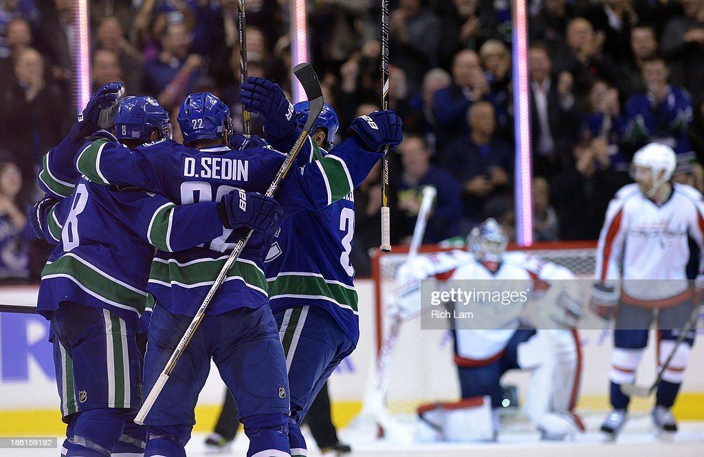 <a gi-track='captionPersonalityLinkClicked' href=/galleries/search?phrase=Daniel+Sedin&family=editorial&specificpeople=202492 ng-click='$event.stopPropagation()'>Daniel Sedin</a> #22 of the Vancouver Canucks is congratulated by <a gi-track='captionPersonalityLinkClicked' href=/galleries/search?phrase=Henrik+Sedin&family=editorial&specificpeople=202574 ng-click='$event.stopPropagation()'>Henrik Sedin</a> #33 and Chris Tanev #8 after scoring a goal on goalie <a gi-track='captionPersonalityLinkClicked' href=/galleries/search?phrase=Michal+Neuvirth&family=editorial&specificpeople=3205600 ng-click='$event.stopPropagation()'>Michal Neuvirth</a> #30 of the Washington Capitals during the third period in NHL action on October 28, 2012 at Rogers Arena in Vancouver, British Columbia, Canada.