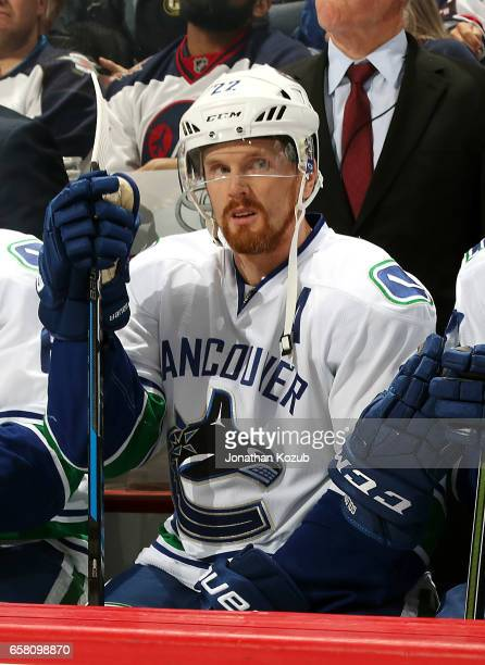 Daniel Sedin of the Vancouver Canucks looks on from the bench prior to puck drop against the Winnipeg Jets at the MTS Centre on March 26 2017 in...