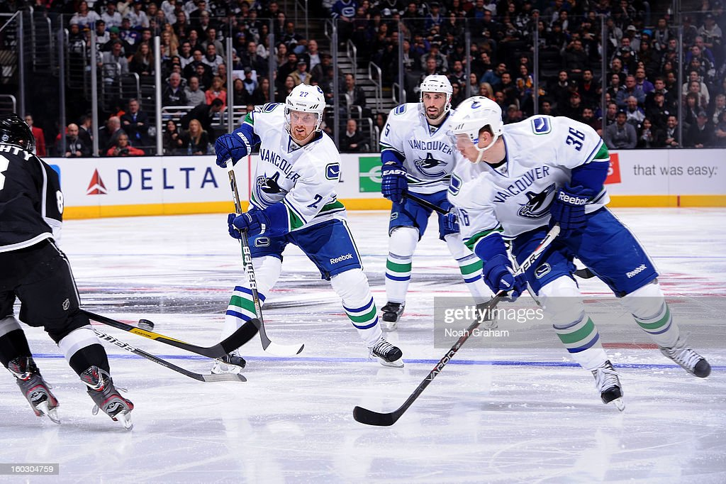<a gi-track='captionPersonalityLinkClicked' href=/galleries/search?phrase=Daniel+Sedin&family=editorial&specificpeople=202492 ng-click='$event.stopPropagation()'>Daniel Sedin</a> #22 of the Vancouver Canucks passes the puck against the Los Angeles Kings at Staples Center on January 28, 2013 in Los Angeles, California.