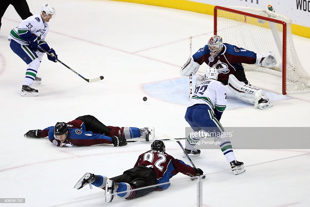 <a gi-track='captionPersonalityLinkClicked' href=/galleries/search?phrase=Daniel+Sedin&family=editorial&specificpeople=202492 ng-click='$event.stopPropagation()'>Daniel Sedin</a> #22 of the Vancouver Canucks passes the puck to <a gi-track='captionPersonalityLinkClicked' href=/galleries/search?phrase=Henrik+Sedin&family=editorial&specificpeople=202574 ng-click='$event.stopPropagation()'>Henrik Sedin</a> #33 of the Vancouver Canucks as <a gi-track='captionPersonalityLinkClicked' href=/galleries/search?phrase=Gabriel+Landeskog&family=editorial&specificpeople=6590816 ng-click='$event.stopPropagation()'>Gabriel Landeskog</a> #92 of the Colorado Avalanche and <a gi-track='captionPersonalityLinkClicked' href=/galleries/search?phrase=Erik+Johnson+-+Ice+Hockey+Player&family=editorial&specificpeople=457696 ng-click='$event.stopPropagation()'>Erik Johnson</a> #6 of the Colorado Avalanche dive to the ice to help goalie <a gi-track='captionPersonalityLinkClicked' href=/galleries/search?phrase=Semyon+Varlamov&family=editorial&specificpeople=6264893 ng-click='$event.stopPropagation()'>Semyon Varlamov</a> #1 of the Colorado Avalanche defend the goal at Pepsi Center on February 9, 2016 in Denver, Colorado.