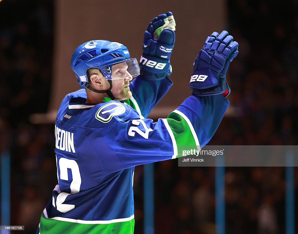 <a gi-track='captionPersonalityLinkClicked' href=/galleries/search?phrase=Daniel+Sedin&family=editorial&specificpeople=202492 ng-click='$event.stopPropagation()'>Daniel Sedin</a> #22 of the Vancouver Canucks salutes the fans after being named first star in the NHL game against the Washington Capitals at Rogers Arena on October 28, 2013 in Vancouver, British Columbia, Canada. Vancouver won 3-2.