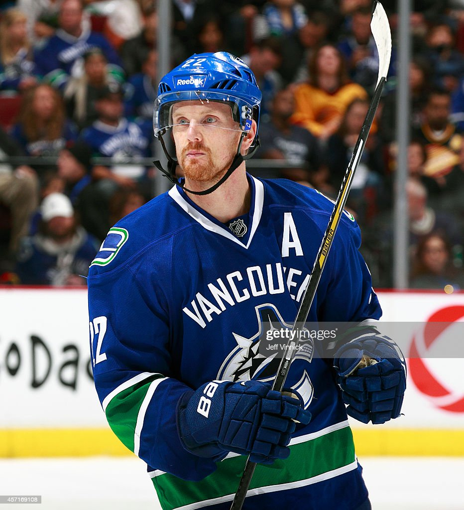 <a gi-track='captionPersonalityLinkClicked' href=/galleries/search?phrase=Daniel+Sedin&family=editorial&specificpeople=202492 ng-click='$event.stopPropagation()'>Daniel Sedin</a> #22 of the Vancouver Canucks skates up ice during their NHL game against the Edmonton Oilers at Rogers Arena October 11, 2014 in Vancouver, British Columbia, Canada. Vancouver won 5-4 in a shootout.