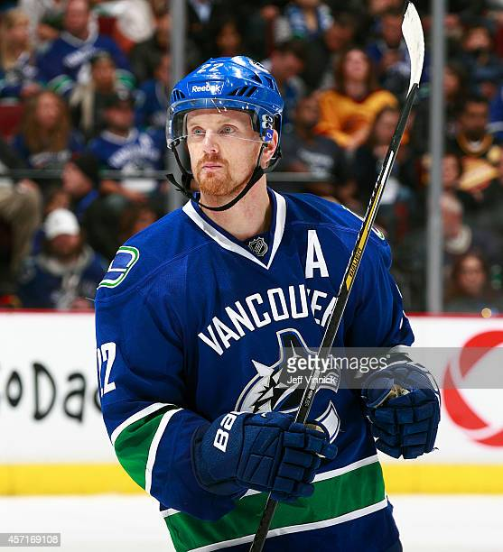 Daniel Sedin of the Vancouver Canucks skates up ice during their NHL game against the Edmonton Oilers at Rogers Arena October 11 2014 in Vancouver...