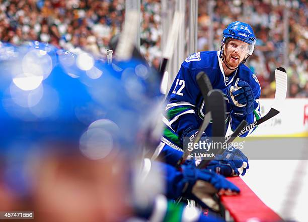 Daniel Sedin of the Vancouver Canucks talks to his teammates during their NHL game against the Tampa Bay Lightning at Rogers Arena October 18 2014 in...