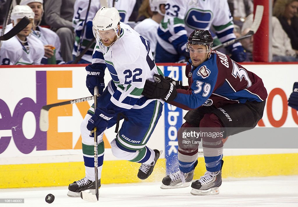 <a gi-track='captionPersonalityLinkClicked' href=/galleries/search?phrase=Daniel+Sedin&family=editorial&specificpeople=202492 ng-click='$event.stopPropagation()'>Daniel Sedin</a> #22 of the Vancouver Canucks tries to break away from TJ Galiardi #39 of the Colorado Avalanche during the third period in NHL action on October 26, 2010 at Rogers Arena in Vancouver, British Columbia, Canada.