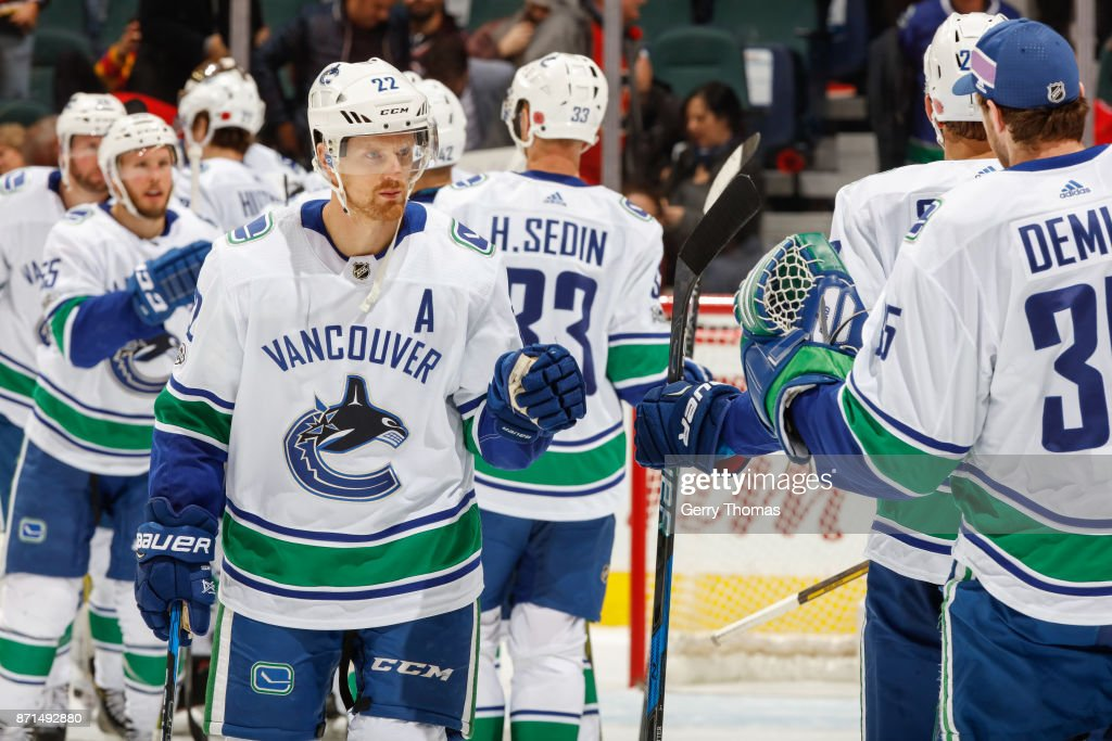 Daniel Sedin #22 salutes teammates after an NHL game against the Calgary Flames at the Scotiabank Saddledome on November 7, 2017 in Calgary, Alberta, Canada.