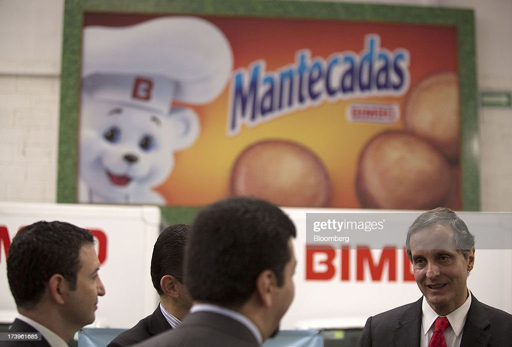 Daniel Servitje, chief executive officer of Grupo Bimbo SAB de CV, right, speaks with attendees during an event at the company's new sales center in Mexico City, Mexico, on Thursday, July 18, 2013. Grupo Bimbo inaugurated a new eco-friendly sales center today. Photographer: Susana Gonzalez/Bloomberg via Getty Images
