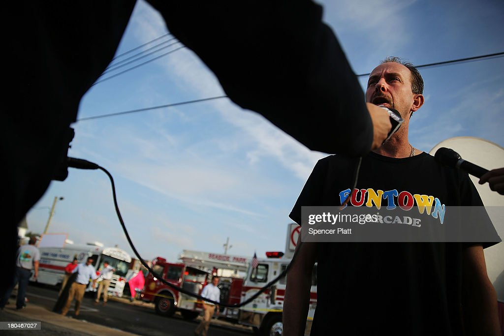 Daniel Shauger, manager at the heavily damaged Funtown Arcade, stands at the scene of a massive fire that destroyed dozens of businesses along an iconic Jersey shore boardwalk on September 13, 2013 in Seaside Heights, New Jersey. The 6-alarm fire began in a frozen custard stand on the recently rebuilt boardwalk around 2:00 p.m. on Thursday, September 12, and quickly spread in high winds. While there were no injuries reported, many businesses that had only recently re-opened after Hurricane Sandy were destroyed in the blaze.