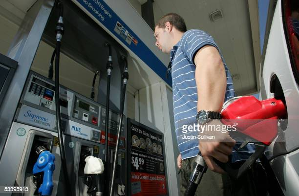 Daniel Sherman pumps gasoline into his car at a Chevron filling station August 16 2005 in San Francisco California Retail gasoline prices rose 182...