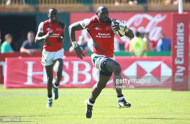 Daniel Sikuta of Kenya scores a try against Australia during day one of the Emirates Dubai Sevens HSBC Sevens World Series on December 5 2014 in...