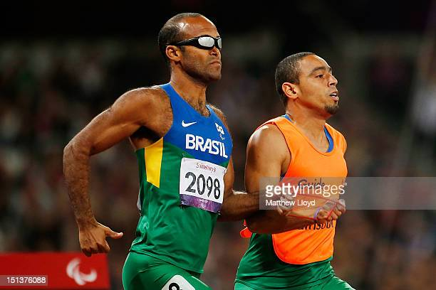 Daniel Silva of Brazil runs with his guide Leonardo Souza Lopes during heat 3 of the Men's 400m T11 the on day 8 of the London 2012 Paralympic Games...