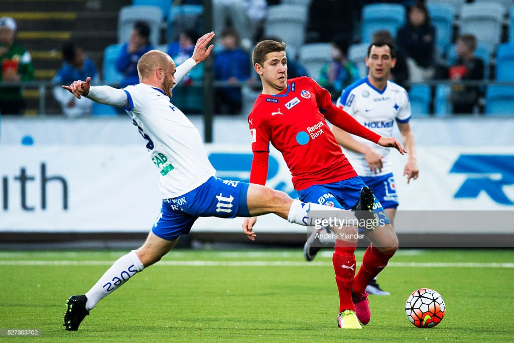 Daniel Sjolund of IFK Norrkoping and Darijan Bojanic of Helsingborgs IF competes for the ball during the Allsvenskan match between IFK Norrkoping and Helsingborgs IF at Ostgotaporten on May 2, 2016 in Norrkoping, Sweden.