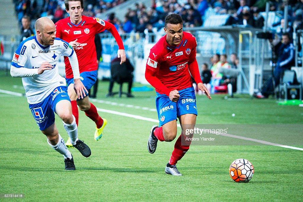 Daniel Sjolund of IFK Norrkoping and Matthew Rusike of Helsingborgs IF competes for the ball during the Allsvenskan match between IFK Norrkoping and Helsingborgs IF at Ostgotaporten on May 2, 2016 in Norrkoping, Sweden.