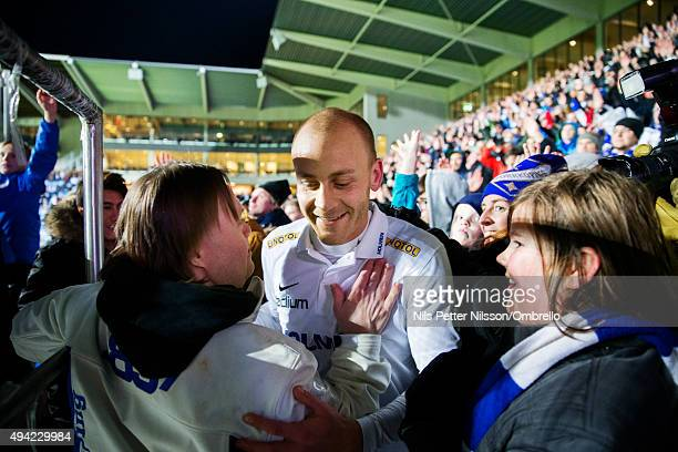 Daniel Sjolund of IFK Norrkoping celebrates the win together with fans after the IFK Norrkoping vs Halmstad BK Allsvenskan match at Nya Parken on...