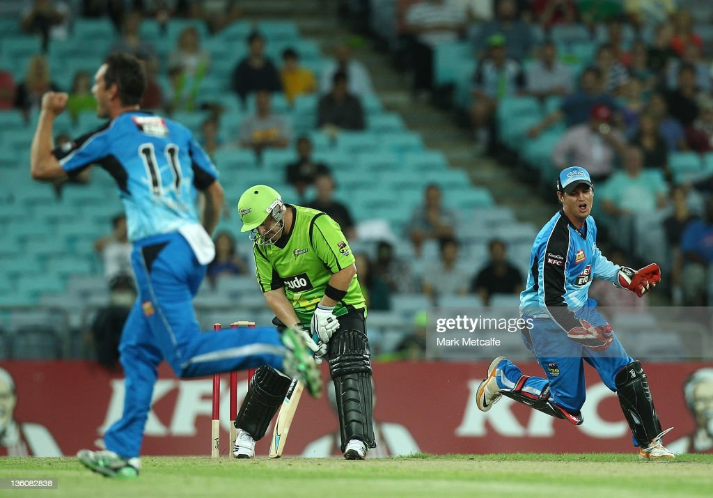 Daniel Smith of the Thunder is bowled by Aaron O'Brien of the Strikers during the T20 Big Bash League match between the Sydney Thunder and the Adelaide Strikers at ANZ Stadium on December 23, 2011 in Sydney, Australia.
