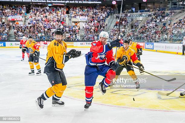 Daniel Sondell of HCL and Garrett Festerling of Adler during the Champions Hockey League match between Adler Mannheim and HC Lugano at SAP on August...