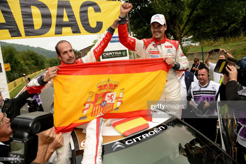 Daniel Sordo of Spain and Carlos Del Barrio of Spain celebrate their victory during Day Four of the WRC Germany on August 25, 2013 in Trier, Germany.