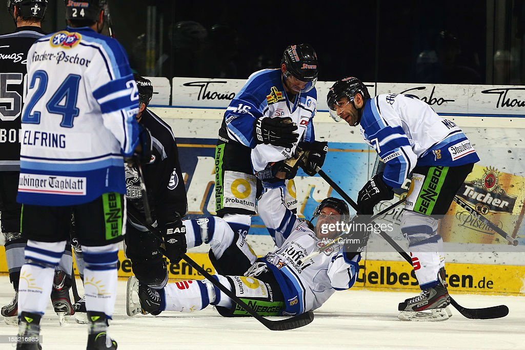 Daniel Sparre (bottom) celebrates with team mates after scoring an irregular goal during the DEL match between Thomas Sabo Ice Tigers and Straubing Tigers at Arena Nuernberger Versicherung on December 11, 2012 in Nuremberg, Germany.