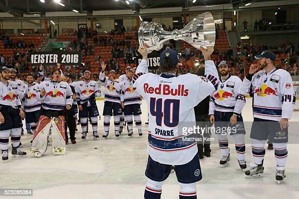 Daniel Sparre of Muenchen and his team mates pose with the trophy after winning the DEL playoffs final game four between Grizzlys Wolfsburg and Red...