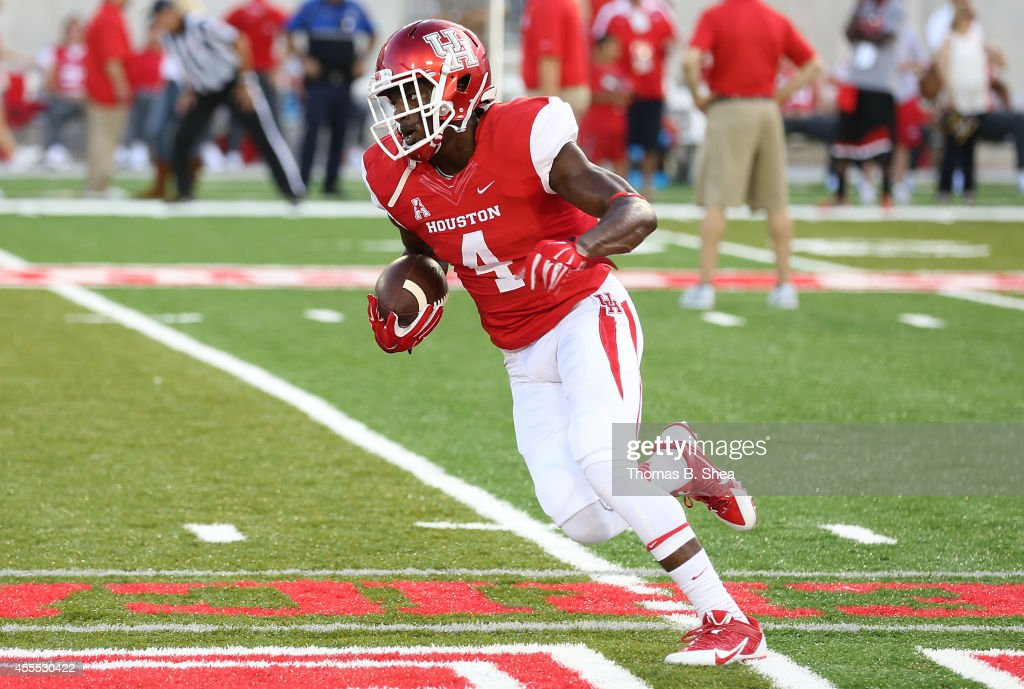 Daniel Spencer #4 of the Houston Cougars warms up before playing against the Grambling State Tigers on September 6, 2014 at TDECU Stadium in Houston, Texas.