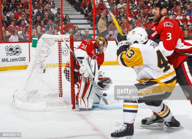 Daniel Sprong of the Ottawa Senators makes a save as Marc Methot defends against Conor Sheary of the Pittsburgh Penguins in Game Four of the Eastern...