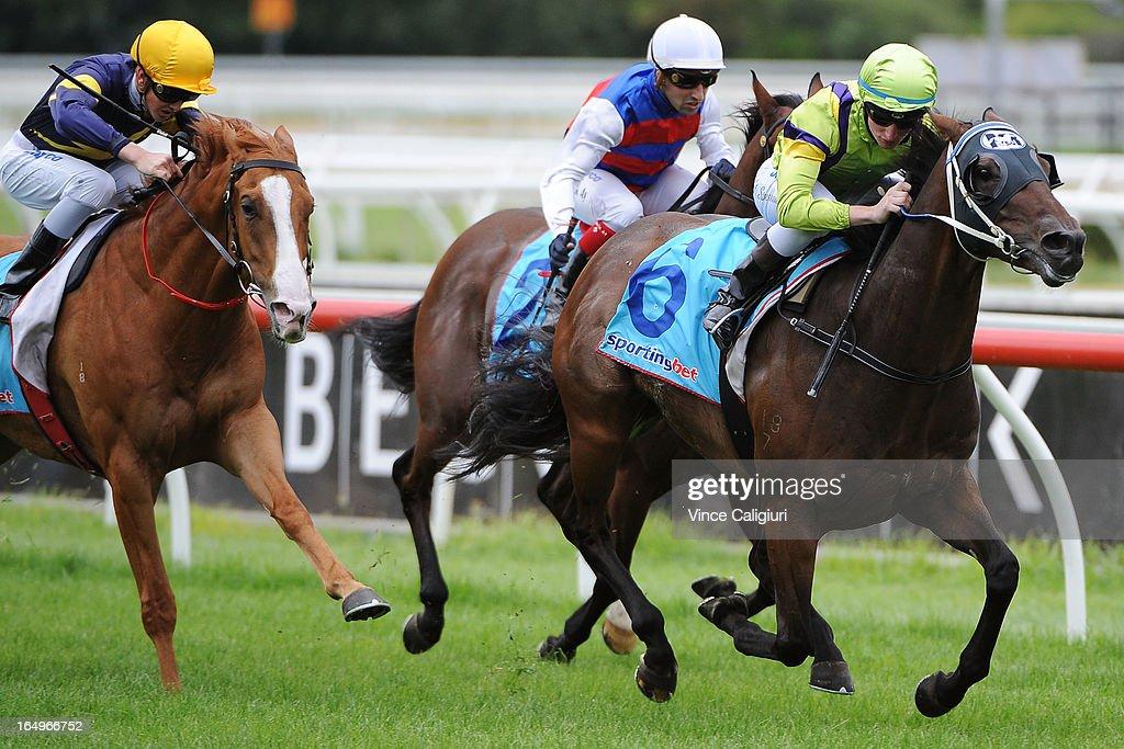 Daniel Stackhouse riding Cosmic Causeway wins the Jack Elliott Handicap during Melbourne Racing at Caulfield Racecourse on March 30, 2013 in Melbourne, Australia.