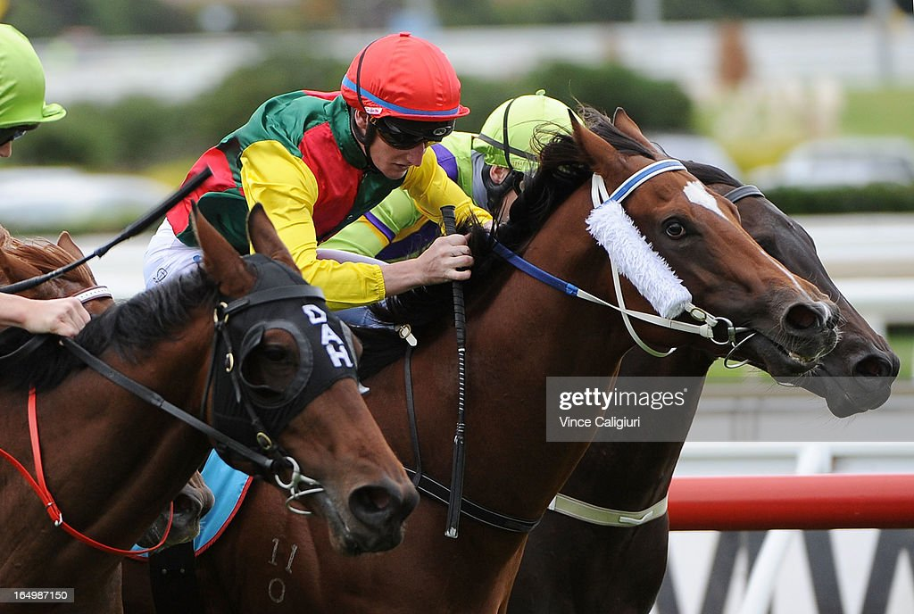 Daniel Stackhouse riding Weinholt wins the Geoff Murphy Handicap during Melbourne Racing at Caulfield Racecourse on March 30, 2013 in Melbourne, Australia.