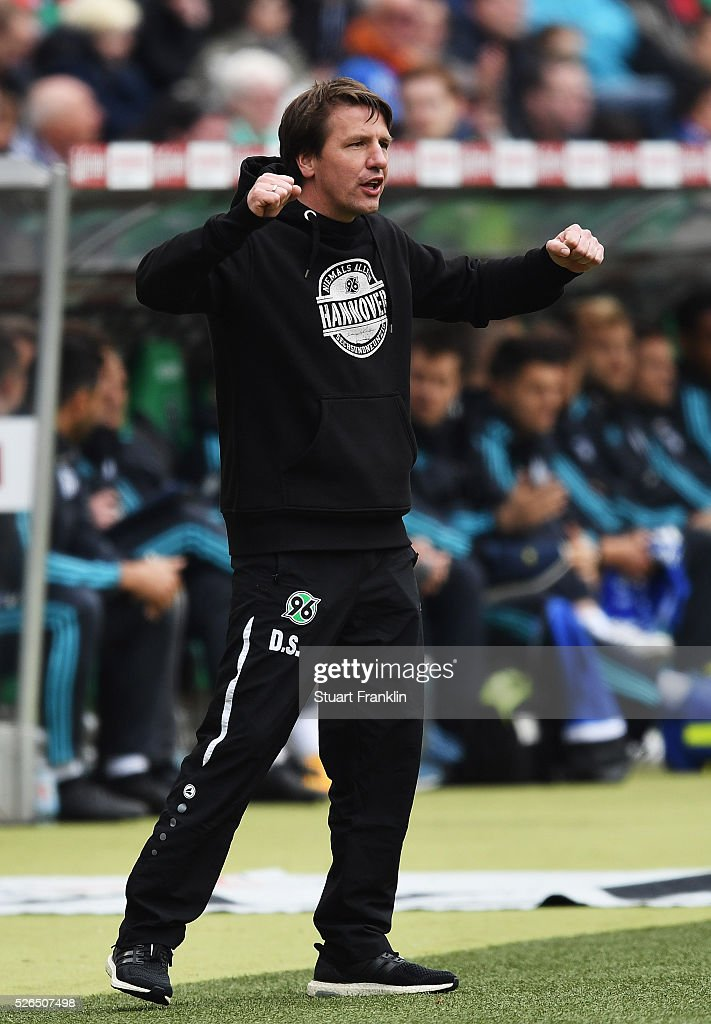 Daniel Stendel, head coach of Hannover celebrates during the Bundesliga match between Hannover 96 and FC Schalke 04 at the HDI Arena on April 30, 2016 in Hanover, Lower Saxony.