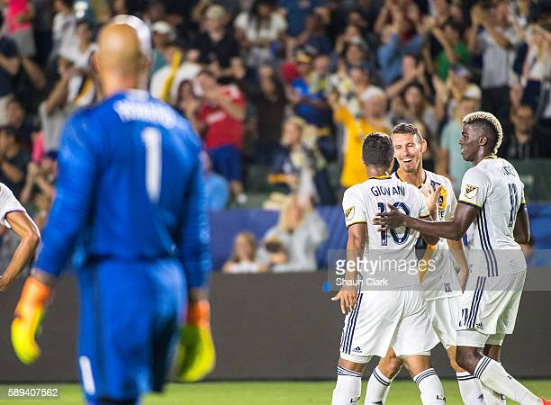 Daniel Steres of Los Angeles Galaxy celebrates his goal with Giovani dos Santos and Gyasi Zerdes of Los Angeles Galaxy during Los Angeles Galaxy's...