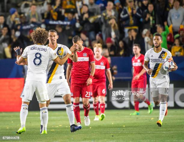 Daniel Steres of Los Angeles Galaxy celebrates his goal with Joao Pedro of Los Angeles Galaxy during Los Angeles Galaxy's MLS match against Chicago...