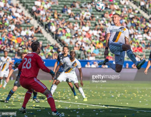 Daniel Steres of Los Angeles Galaxy heads a cross toward goal during the Los Angeles Galaxy's MLS match against San Jose Earthquakes at the StubHub...